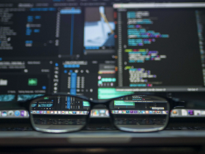 Glasses in front of computer
